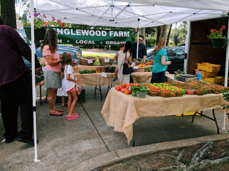Inglewood Farm's booth at the Alexandria Farmer's Market held in the Garden District.
