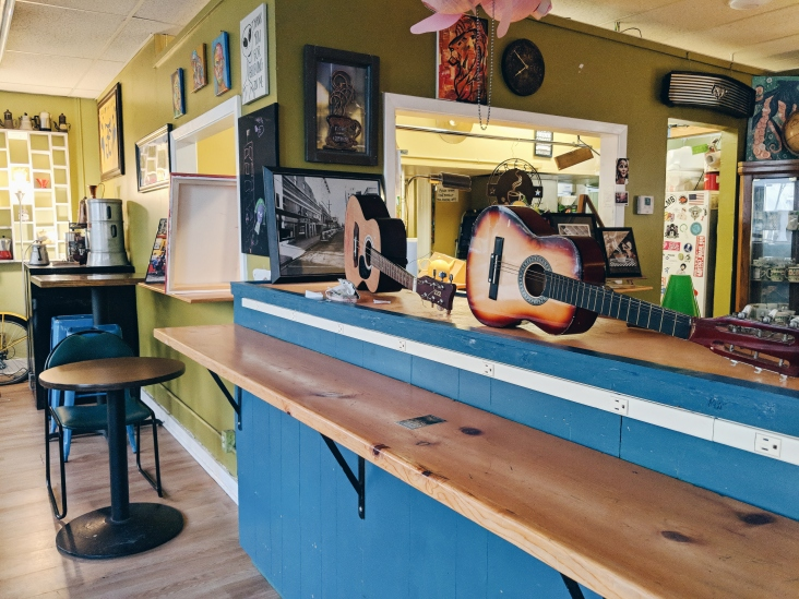 Guitars and local art on display.