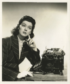 "Rosalind Russell plays a female reporter in 1940 film ""His Girl Friday"""